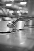 Kitchen, focus on saucepans, black & white photo