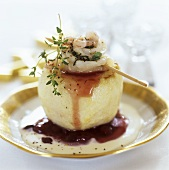 Apple stuffed with seafood salad and cranberry sauce