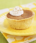 Small chocolate tart with whipped cream