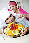 Man and woman tempted by fruit tart