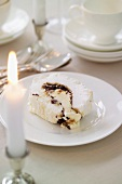Meringue roll filled with sweet mincemeat and brandy cream