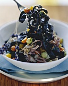 Black ribbon pasta with calamaretti, fennel and lavender