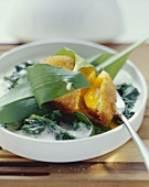 Deep-fried poached eggs on creamed spinach with ramsons