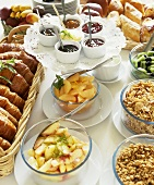 Breakfast buffet: muesli, fruit, jams, baked goods