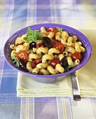Pasta salad with tomatoes, olives and pesto
