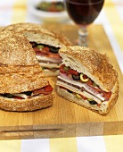 Large sausage, cheese and vegetable sandwich