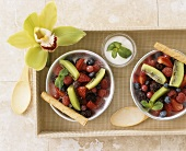 Berry and kiwi fruit salad in two bowls