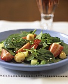 Spinach salad with strawberries and macadamia nuts