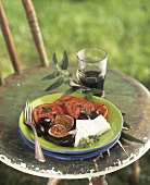 Greek appetiser plate: tomatoes, olives, figs & feta cheese