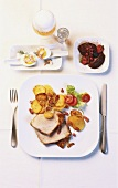 Roast pork with crackling, stuffed eggs, mousse au chocolat