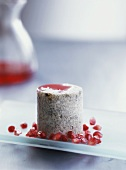 Rice mould with poppy seeds and pomegranate seeds