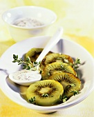 Fried kiwi fruit slices with poppy seed yoghurt