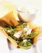 Redfish fillet with kiwi fruit & green beans in baking parchment