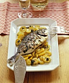 Oven-baked gilthead bream and potatoes