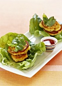 Corn cakes on lettuce with dip