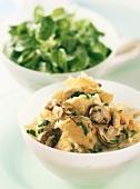 Savoury mushroom and nut pancake pieces with corn salad