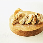 Slices of various kinds of bread on wooden board