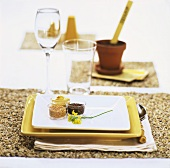 Place setting with mustard, mustard seeds & mustard flower