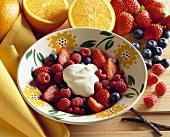 Berry salad with orange cream