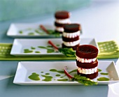Towers of beetroot and goat's cheese on parsley sauce