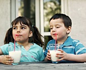 Two children drinking milk