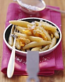 Sweet potato noodles with almond praline & icing sugar