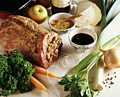 Ingredients for roast pork roll with apple and celery