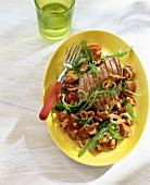 Tuna steak on chanterelle salad