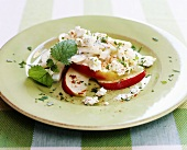 Kohlrabi and apple salad with fresh goat's cheese