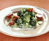 Broccoli salad with cherry tomatoes and spring onions
