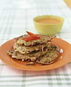 Vegetable rosti with pepper sauce