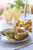 Crepe with kumquat sauce