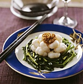 Shrimps and walnuts on green vegetables