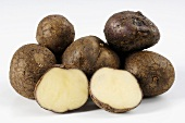 Several potatoes, variety 'Odenwälder Blaue', whole & half