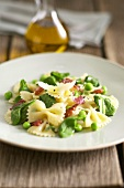 Farfalle with peas, bacon and basil