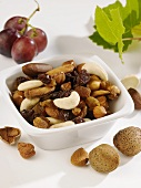 Nuts and raisins in a small bowl