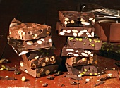 Several bars of nut chocolate, in a pile