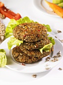 Four vegetable burgers in a pile