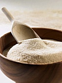 Cane sugar in a wooden bowl