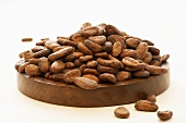 Cocoa beans on a wooden board
