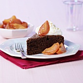 A piece of chocolate cake with peach compote
