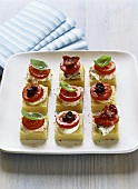 Polenta slices with cherry tomatoes & cheese