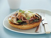 Pizza bun with ham and mushrooms