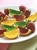 Assorted fruit jellies and strawberries