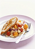 Fried chicken breast fillet with couscous salad