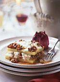 Polenta slices with mince sauce & cheese topping