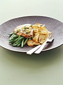 Veal escalopes with beans and potato crisps