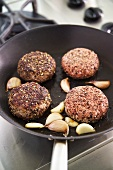 Frying burgers in a frying pan