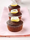 Three chocolate muffins with sweet decoration