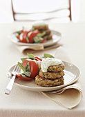 Onion and lentil cakes with minted yoghurt